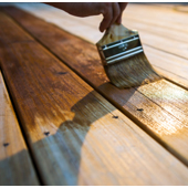 Finishing a deck surface with sealer