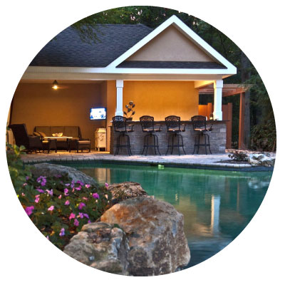 A stone deck around pool
