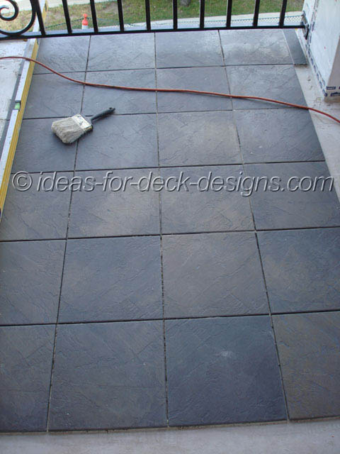 Install the tiles over the bond coat