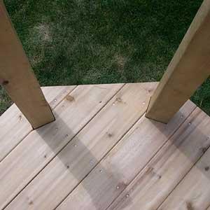 Deck boards cut around posts