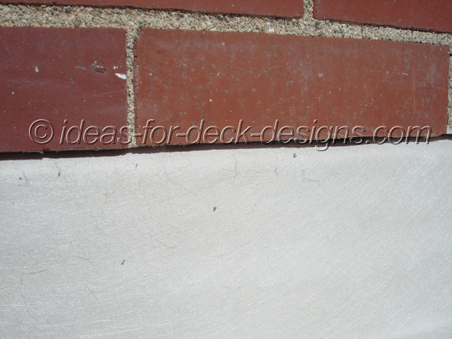 Wall flash detail of membrane under brick