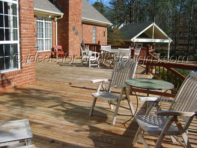 A wood deck before deck pavers installed