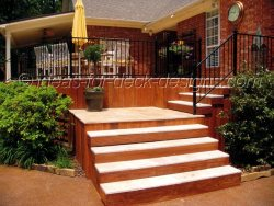 Wood deck stairs with pavers