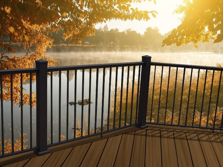Aluminum railing with slim pickets at sunrise