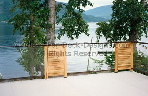 Waterproof deck surface with combination metal and glass railing
