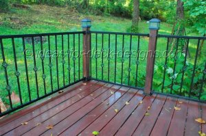 Contrasting wood and metal for deck railing