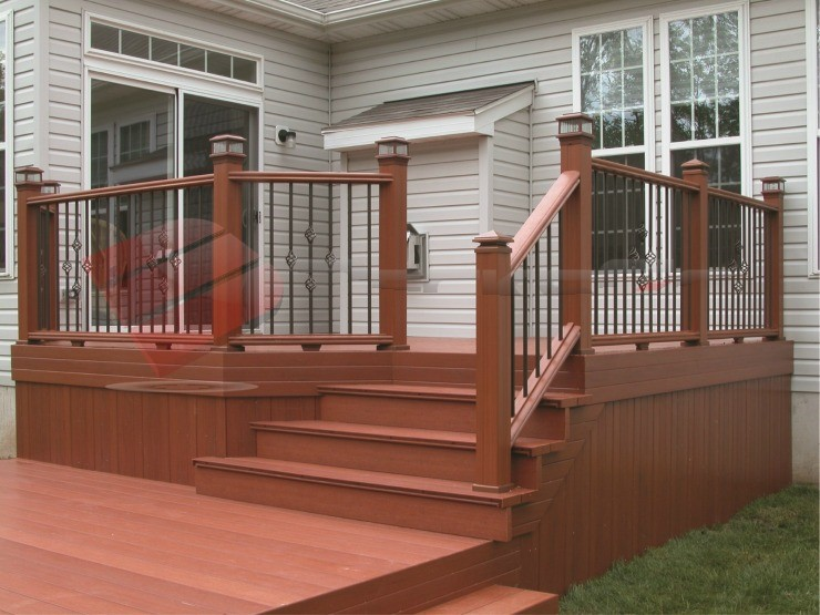 Check out this beautiful composite deck! Its simple design is accompanied by decorative black balusters to add something special.