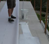 Apply adhesive to cement board