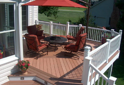 A well built composite deck can be exquisite as this example shows.  Herring bone board patterns combined with contrasting colored picture framed borders really show off this material at its best.