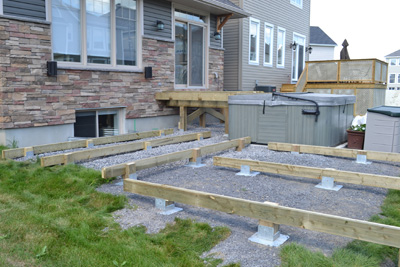 Titan deck foot ground anchored deck footings in a for Free standing hot tub deck