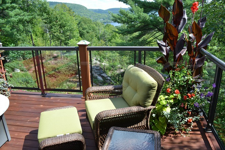 Nothing is better than a beautiful deck paired with a breathtaking view. This deck features just that: A magnificent view of the foliage and greenery of the mountain side.