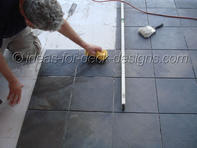 Grout tiles for a finished deck