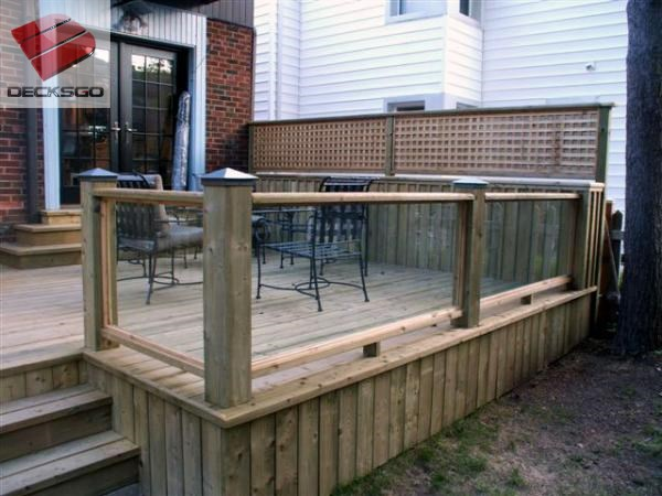 Treated wood deck with glass rails.