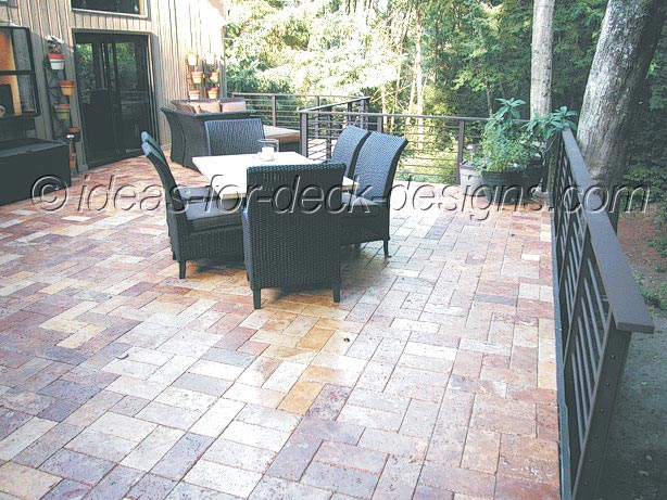 A finished paver stone deck on wood frame