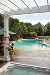 White pergola roof over spa hot tub and deck