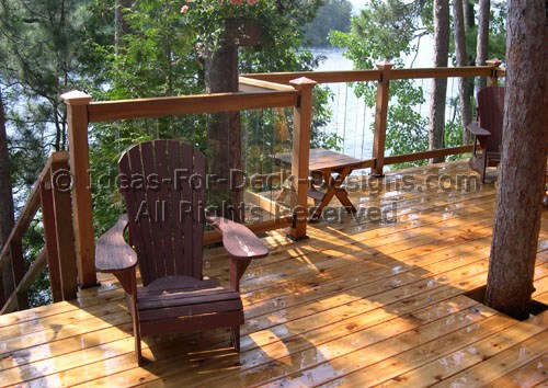 Glass deck railing choose wood or aluminum for Garden decking glass panels