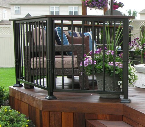 Metal posts and pickets with exotic hardwood cap rail
