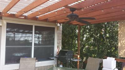 Close view of pergola roof against house