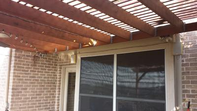 Another vlose view of pergola roof against house
