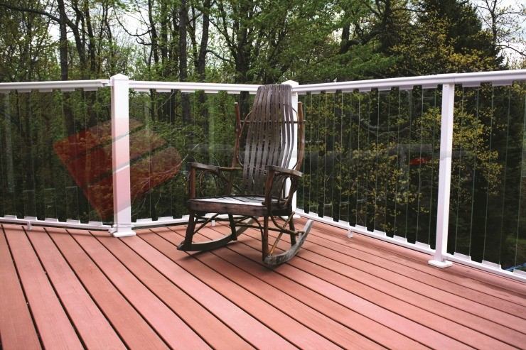 White aluminum railing posts complemented by glass balusters create and open and airy view off of the deck.