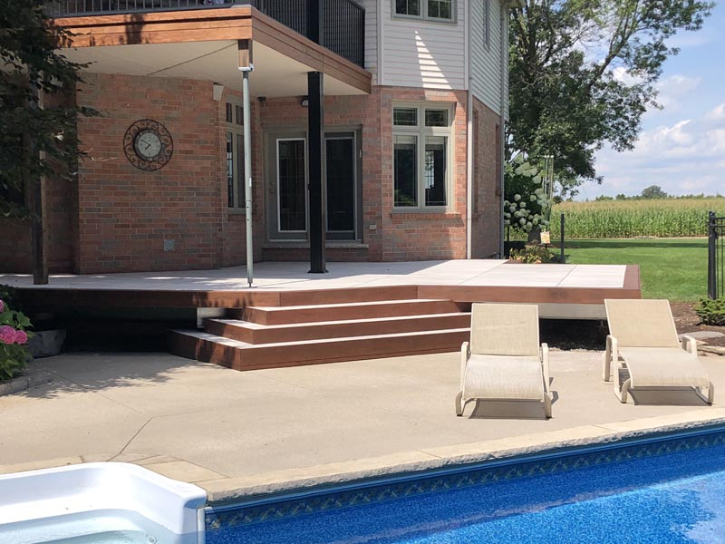 Tropical hardwood fascia and picture framing over stone infill deck.