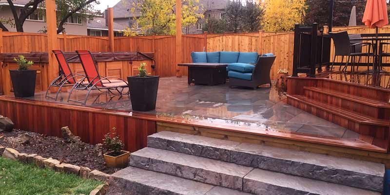 Wood picture framed deck with stone infield over Silca grid.