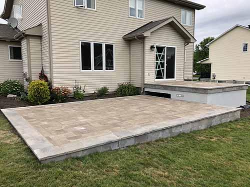 Finished multi level stone decks built using Paverdeck.
