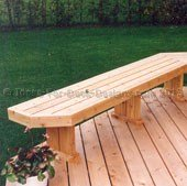 A beautiful wood bench built on to a classic cedar deck.