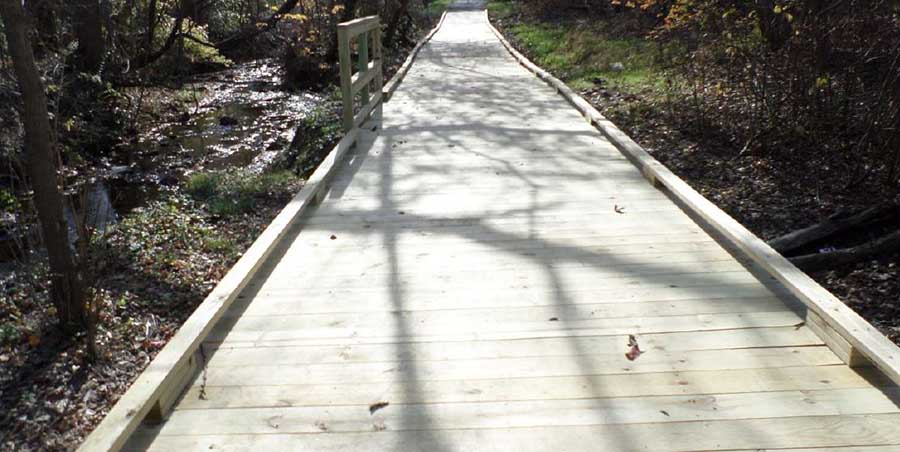 Wooden boardwalk built with deck foot anchors