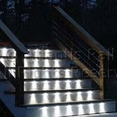 A cable stair rail with stair lighting.