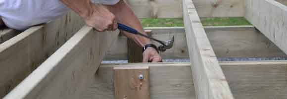 Carpenter showing how to build a deck