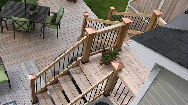 Decking installed perpendicular to house after framing