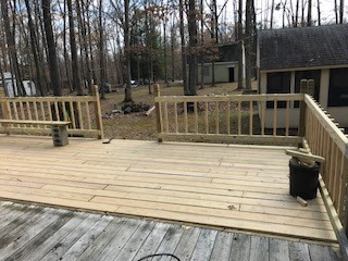 New deck addition with treated wood decking.