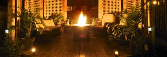 Deck with fire pit and lamps