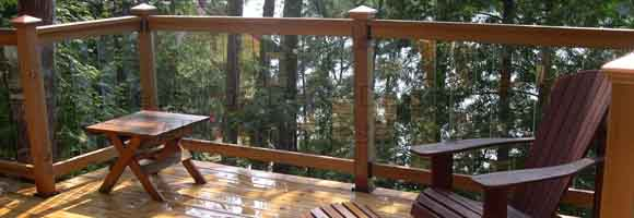 Glass panels in cedar wood frame deck railing
