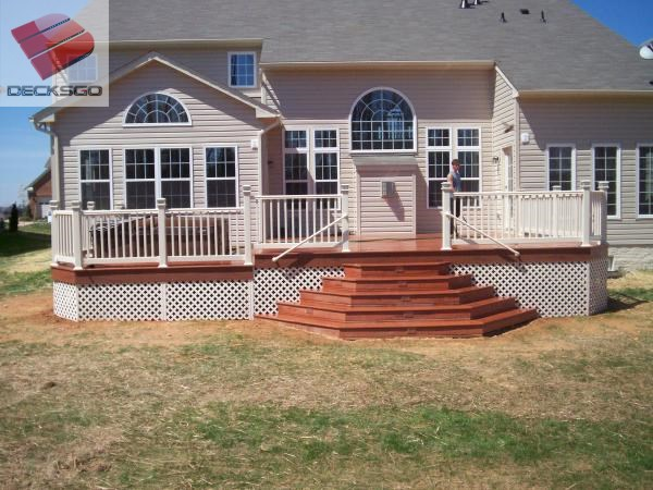 Mid level deck with cascading stairs built by Decks R Us.