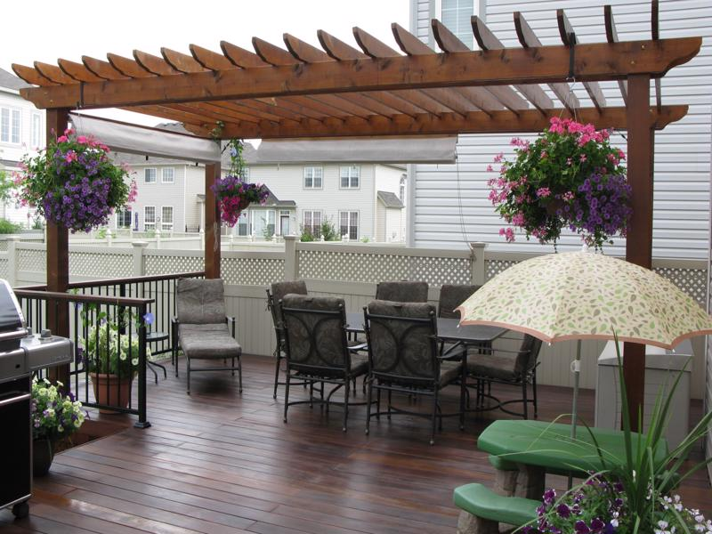 Pergola with deck foot anchor footings