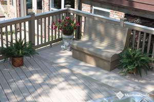 Pale gray composite boards with highlighted grain and built in bench seat