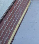 Flashing against brick wall