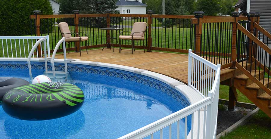 Beautiful treated wood above ground pool deck built using the Titan Deck Foot Anchor.