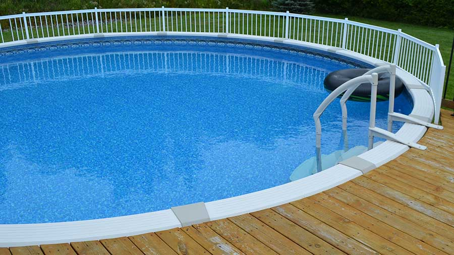 24' diameter above ground pool with deck