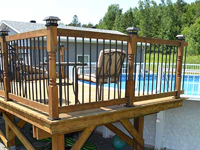 Black aluminum balusters, solar post caps, Titan post anchors for above ground pool deck
