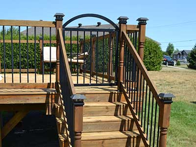 An aluminum gate for an above ground pool deck railing